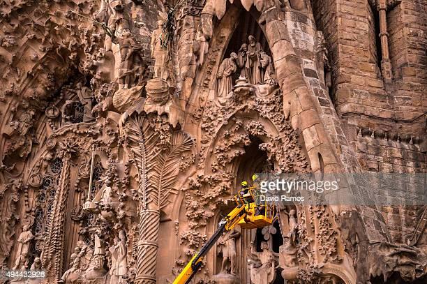 Employees work on the Birth's Facade of 'La Sagrada Familia' on October 26 2015 in Barcelona Spain 'La Sagrada Familia' Foundation announced on...