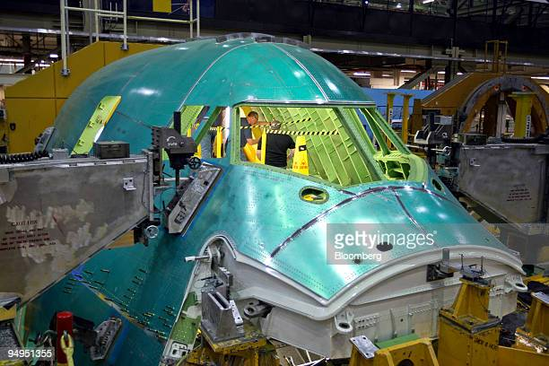 Employees work on the cockpit of a Boeing Co 7478 airplane at Boeing's manufacturing plant where 747 and 787 Dreamliner planes are assembled in...