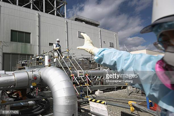 Employees work on the construction of the 'Ice Wall' which will use coolants to create a 30 metre deepl wall of ice to prevent groundwater from...