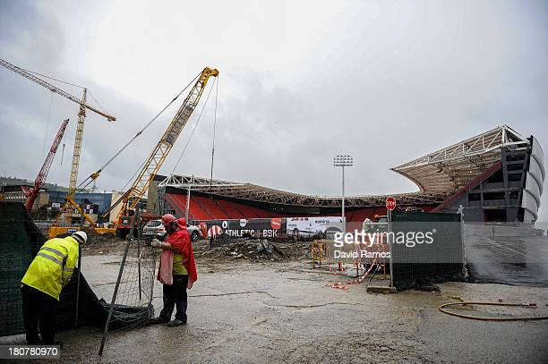 Employees work on the construction of the new San Mames Stadium on September 16 2013 in Bilbao Spain