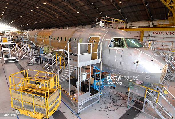 Employees work on the Embraer structural assembly line of the airplane model 170190 at the Empresa Brasileira de Aeronautica SA Embraer manufacturing...