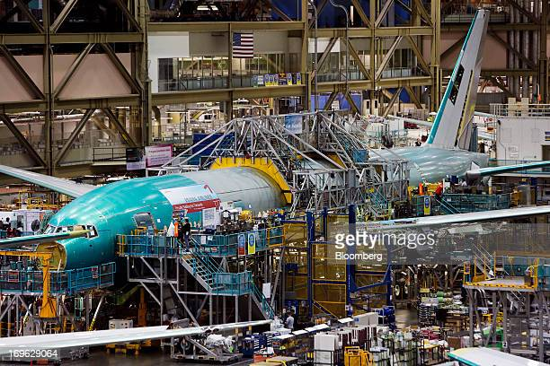 Employees work on the final assembly line of a Boeing Co. 777 airplane at the Boeing Co. Factory in Everett, Washington, U.S., on Tuesday, May 28,...
