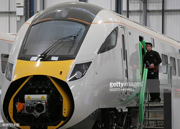 Employees work on the Hitachi Intercity Express Programme train production line at Hitachi's manufacturing plant in Newyton Aycliffe, north-east...