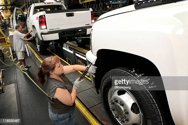 Employees work on the line at the General Motors Co. Assembly plant in Flint, Michigan, U.S., on Monday, July 18, 2011. General Motors Co. Will...