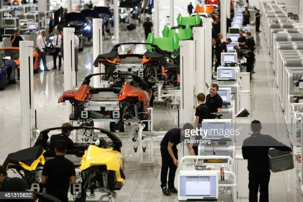 Employees work on the luxury automobile production line at McLaren Automotive Ltd's plant in Woking UK on Friday June 27 2014 George Osborne UK...