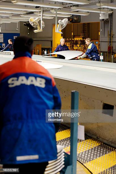 Employees work on the manufacture of spare body parts at the Saab Automobile plant owned by National Electric Vehicle Sweden AB in Trollhaettan...