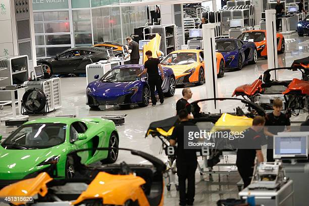 Employees work on the McLaren luxury automobile production line at McLaren Automotive Ltd's plant in Woking UK on Friday June 27 2014 George Osborne...
