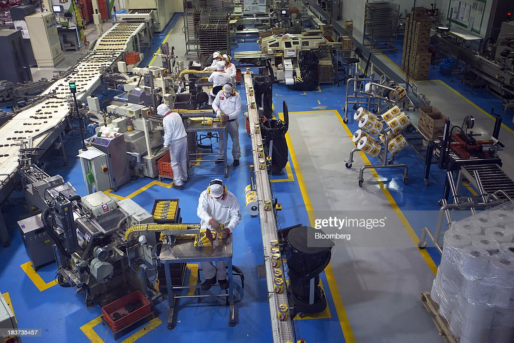 Employees work on the production line at the Nestle SA chocolate