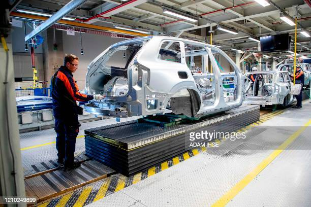 Employees work on the production line at the Volvo car factory in Torslanda Gothenburg Sweden on April 172020 Volvo Cars has started up the...