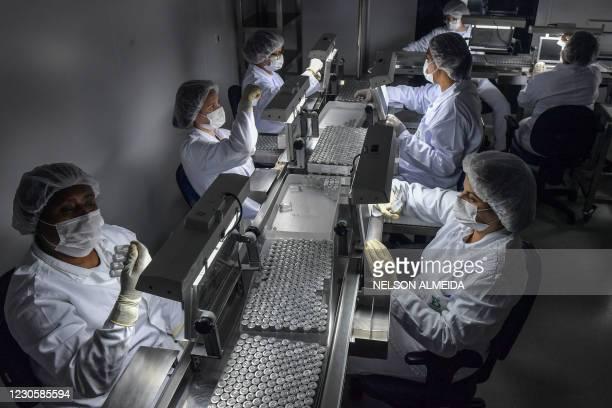 Employees work on the production line of CoronaVac, Sinovac Biotech's vaccine against COVID-19 coronavirus at the Butantan biomedical production...