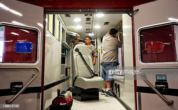 Employees work on the rear of an ambulance at the Horton Emergency Vehicles facility in Grove City Ohio US on Friday Aug 3 2012 Horton Emergency...