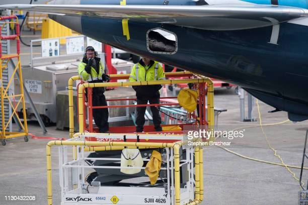 Employees work on the tail section of a Boeing 737 MAX 9 test airplane at Renton Municipal Airport on March 14 2019 in Renton Washington The 737 MAX...