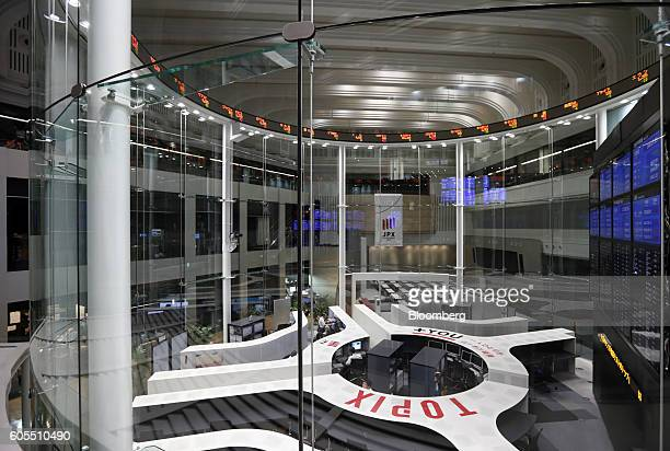 Employees work on the trading floor at the Tokyo Stock Exchange operated by Japan Exchange Group Inc in Tokyo Japan on Wednesday Sept 14 2016 The...