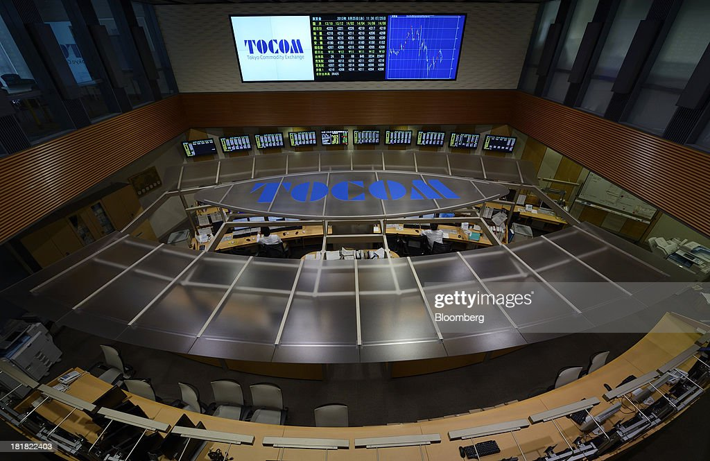 Employees work on the trading floor of the Tokyo Commodity Exchange Inc. (Tocom) in Tokyo, Japan, on Wednesday, Sept. 25, 2013. Tokyo Commodity Exchange, Japan's biggest raw materials bourse, plans to attract more trading from investors in China and India to boost volume that's peaking as the yen's slide stalls near 100 to the dollar. Photographer: Akio Kon/Bloomberg via Getty Images
