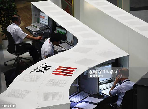 Employees work on the trading floor of the Tokyo Stock Exchange operated by Japan Exchange Group Inc in Tokyo Japan on Tuesday Aug 25 2015 Japanese...