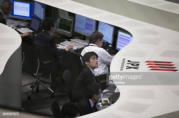 Employees work on the trading floor of the Tokyo Stock Exchange operated by Japan Exchange Group Inc on the first trading day of the year in Tokyo...