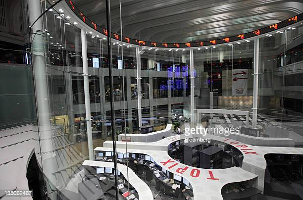 Employees work on the trading floor of the Tokyo Stock Exchange in Tokyo Japan on Thursday Feb 2 2012 The Tokyo Stock Exchange suffered its biggest...