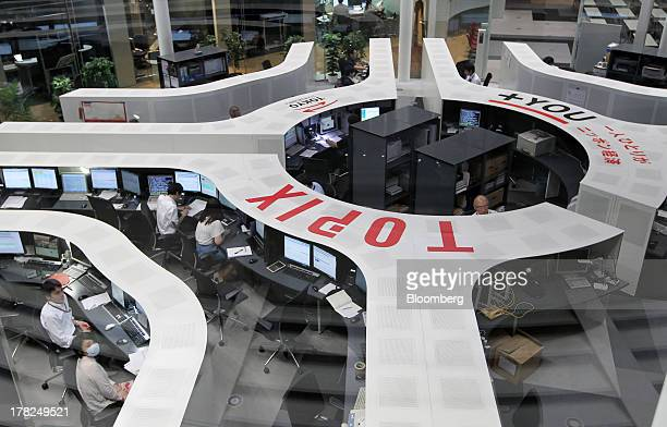 Employees work on the trading floor of the Tokyo Stock Exchange in Tokyo, Japan, on Wednesday, Aug. 28, 2013. Japanese shares declined, with the...