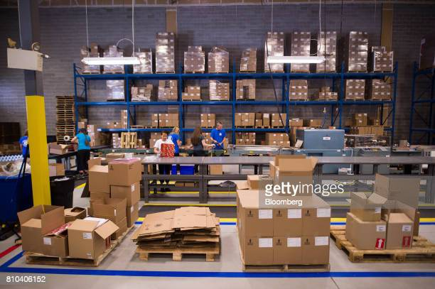 Employees work on the vinyl record packaging line at the Precision Record Pressing facility in Burlington Ontario Canada on Friday June 30 2017...