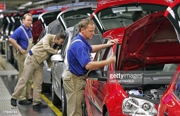 Employees work on Volkswagen Golf cars on a production line 16 November 2007 at the Volkswagen plant in Zwickau, eastern Germany. Volkswagen, the...