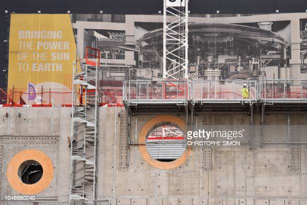 Employees work outside the ITER construction site where will be installed the Tokamak, a confinement device being developed to produce controlled...