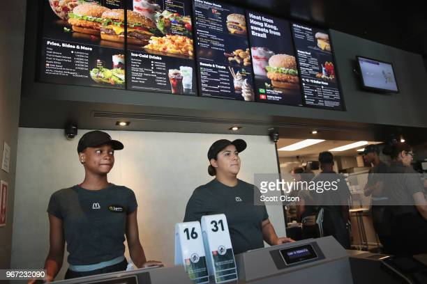 Employees work the counter at a McDonald's restaurant located inside the company's new corporate headquarters on June 4 2018 in Chicago Illinois...