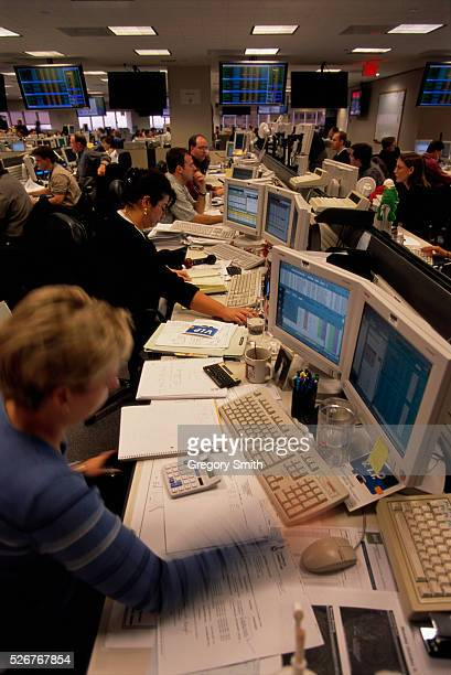 Employees working at their computers on the gas trading floor of the giant energy corporation Enron