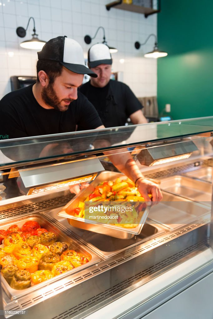 Employees working in zero waste oriented grocery and take out food store. : Stock Photo