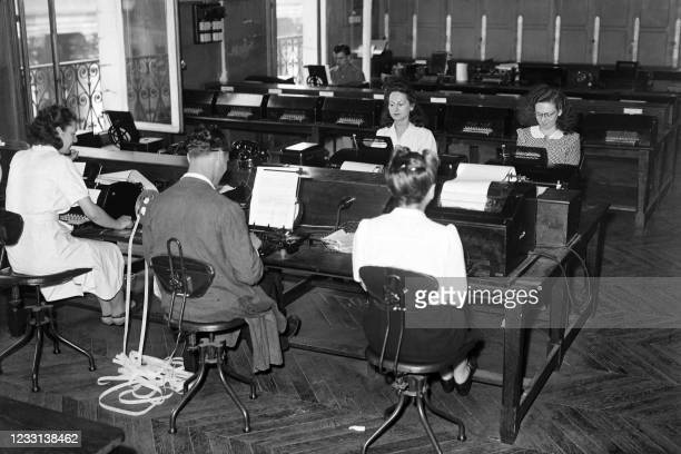 Employees works in the transmissions and switchboard service of the French press agency Agence France Presse in Paris in June 1947.