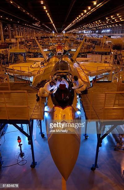 Employeez work on the end of the assembly line in a Lockheed Martin plant that makes Raptors January 15 2003 in Marietta Georgia The United States...