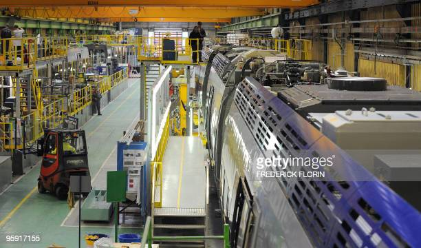 Employes of French industrial giant Alstom work during the assembling of a TGV highspeed train at the AlstomTransport plant on January 20 2010 in...