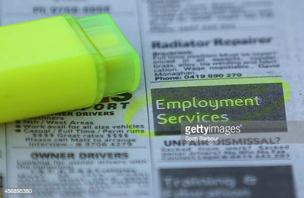 Employment advertisements are highlighted in a newspaper on October 9 2014 in Melbourne Australia Economists expect the Australian jobs figure for...