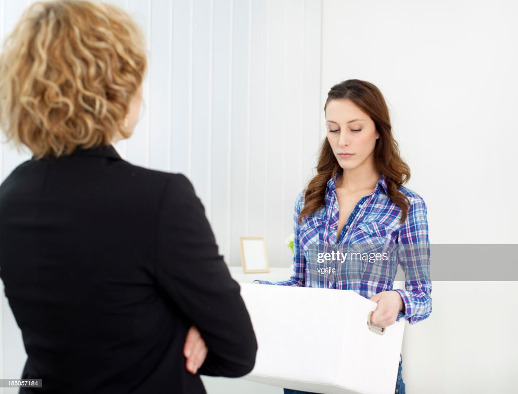 Employment Issues: Businesswoman being fired. : Stock Photo