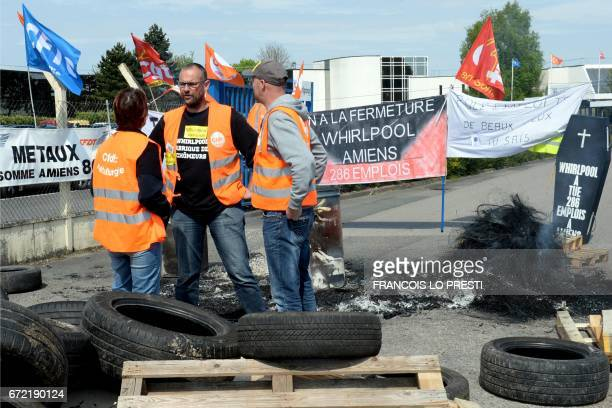 Employs of the US appliance manufacturer Whirlpool wearing an highvisibility jacket of the French General Confederation of Labour union speak...
