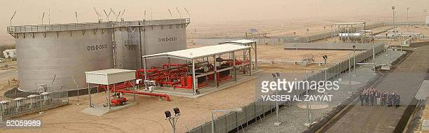 Emplyees of the Kuwait Oil Company tour 25 January 2005 the Gathering Center No15 of alRawdatain field 100 kms north of Kuwait City following its...