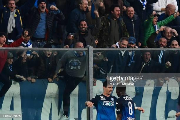 Empoli's Brazilian forward Diego Farias da Silva celebrates with Empoli's Ivorian midfielder Hamed Junior Traore after opening the scoring during the...