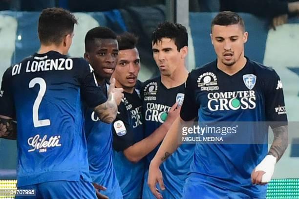 Empoli's Brazilian forward Diego Farias da Silva celebrates with teammates after opening the scoring during the Italian Serie A football match Empoli...