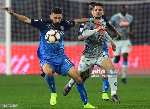 Empoli's Croatian midfielder Marko Pajac holds off Napoli's Belgian forward Dries Mertens during the Italian Serie A football match Empoli vs Napoli...