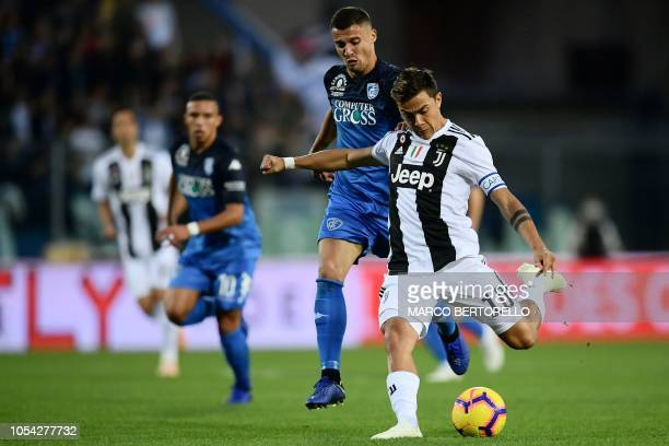 Empoli's defender Giovanni Di Lorenzo from Italy fights for the ball with Juventus' forward Paulo Dybala from Argentina during the Italian Serie A...