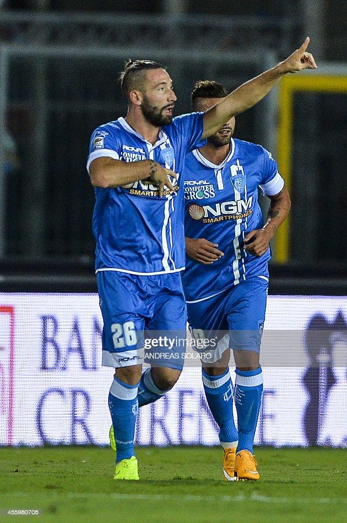 Empoli's defender Lorenzo Tonelli celebrates after scoring during the Italian Serie A football match Empoli vs AC Milan on September 23, 2014 at the Carlo Castellani stadium in Empoli.
