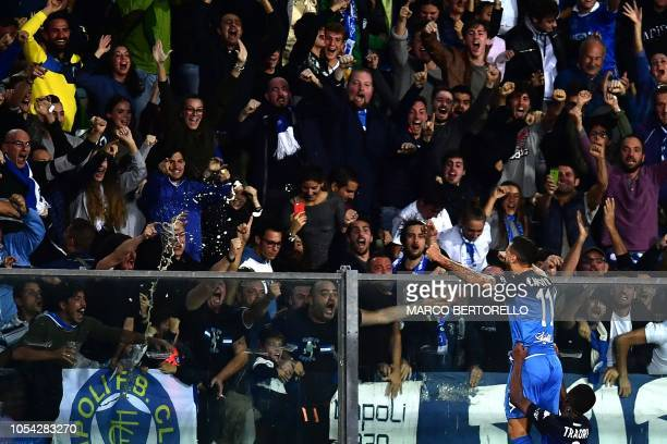 Empoli's forward Francesco Caputo from Italy celebrates with supporters after scoring during the Italian Serie A football match Empoli vs Juventus on...