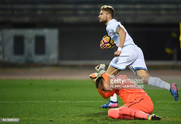 Empoli's goalkeeper from Poland Lukasz Skorupski reacts as Lazio forward from Italy Ciro Immobile celebrates after scoring during the italian Serie A...