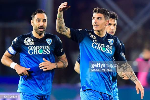 Empoli's Italian defender Giovanni Di Lorenzo celebrates after scoring during the Italian Serie A football match Empoli vs Napoli on April 3, 2019 at...