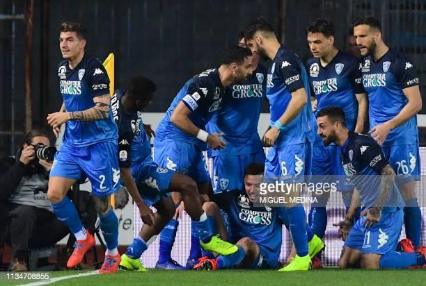 Empoli's Italian defender Giovanni Di Lorenzo celebrates with teammates after scoring during the Italian Serie A football match Empoli vs Napoli on...