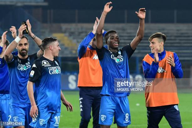 Empoli's Ivorian midfielder Hamed Junior Traore and teammates celebrate at the end of the Italian Serie A football match Empoli vs Napoli on April 3...