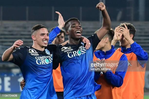 Empoli's Ivorian midfielder Hamed Junior Traore Empoli's Algerian midfielder Ismael Bennacer and teammates celebrate after Empoli defeated Napoli...