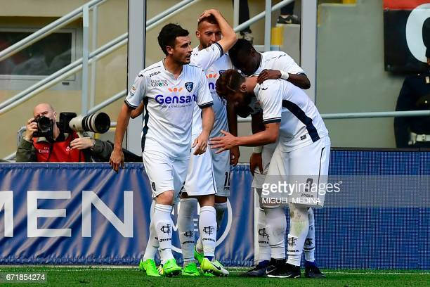 Empoli's players celebrate after scoring during the Italian Serie A football match AC Milan vs Empoli at the San Siro stadium in Milan on April 23...