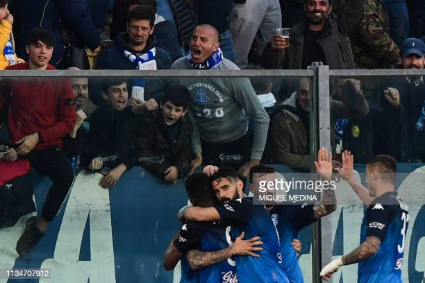 Empoli's players celebrate next to fans after opening the scoring during the Italian Serie A football match Empoli vs Napoli on April 3, 2019 at the...
