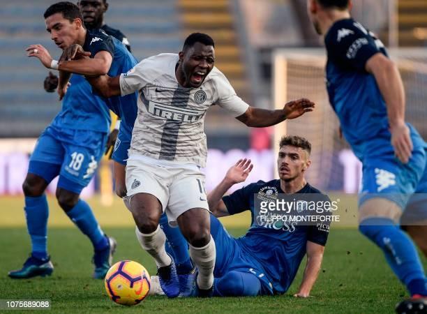 Empoli's Swiss defender Joel Untersee and Empoli's Algerian midfielder Ismael Bennacer tackles Inter Milan's Ghanaian midfielder Kwadwo Asamoah...