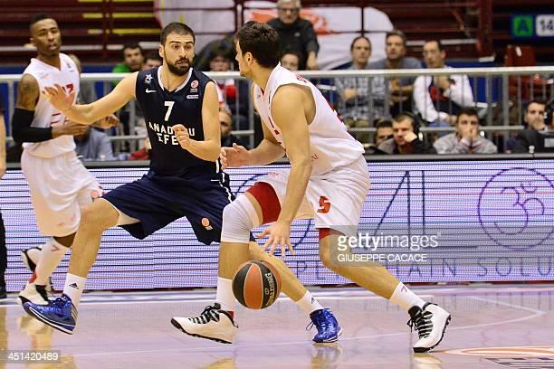 Emporio Armani Milan's guard Alessandro Gentile vies with Efes Pilsen Istanbul's forward Kostas Vasileiadis during the group B Euroleague basketball...